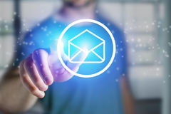 Man touching a email icon on a futuristic interface - Technology. View of a Man touching a email icon on a futuristic interface - Technology concept Royalty Free Stock Image