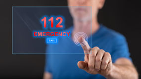 Man touching an emergency concept on a touch screen. With his finger Royalty Free Stock Photography