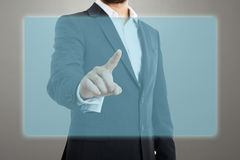Man touching at empty virtual screen Stock Images