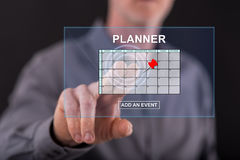Man touching an event adding on planner concept on a touch screen. With his finger Stock Images