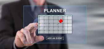 Man touching an event adding on planner concept on a touch screen Royalty Free Stock Image