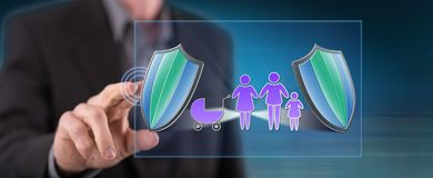 Man touching a family insurance concept. On a touch screen with his finger royalty free stock photography