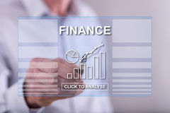 Man touching a finance concept on a touch screen Royalty Free Stock Photo