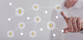 Man touching a financial network on a touch screen Stock Image