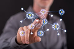 Man touching a financial network on a touch screen Stock Photos