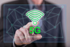 Man touching a 5g concept on a touch screen. With his finger Royalty Free Stock Images