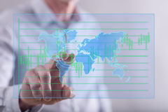 Man touching a global business concept on a touch screen Stock Images