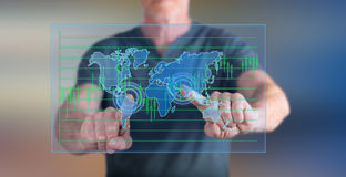 Man touching a global business concept on a touch screen Stock Photography