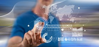 Man touching a global business digital interface concept royalty free stock photography