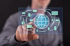 Man touching a global connection concept on a touch screen Royalty Free Stock Photos