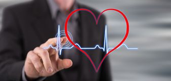 Man touching a heart beats graph Stock Image