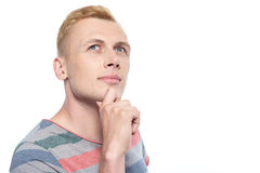 Man touching his chin with fingers Stock Image