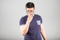 Man touching his glasses Stock Photography