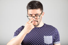 Man touching his glasses Royalty Free Stock Photo