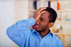 Man touching his head with his hand, suffering face of pain Royalty Free Stock Images