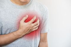 A man touching his heart. Heart attack, heart failure, others heart disease. S stock image