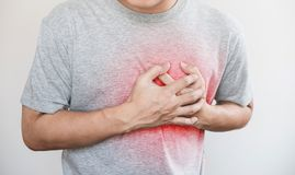 A man touching his heart, with red highlight of heart attack, heart failure, others heart disease and broken heart. A man touching his heart, with red highlight royalty free stock photography