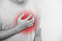 A man touching his heart, with red highlight of heart attack, heart failure and others heart disease. A man touching his heart , with red highlight of heart royalty free stock photos