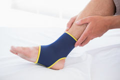 Man touching his injured foot Royalty Free Stock Photos