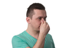 Man Touching His Nose And Has Unpleasant Pain Stock Photo