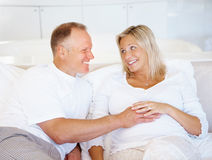 Man touching his pregnant wife tummy Royalty Free Stock Images
