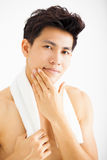 man touching his smooth face after shaving Stock Images