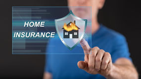 Man touching a home insurance concept on a touch screen. With his finger Stock Photo