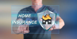 Man touching a home insurance concept on a touch screen Royalty Free Stock Photo