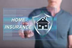 Man touching a home insurance concept on a touch screen royalty free stock photography