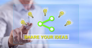 Man touching an ideas sharing concept on a touch screen. With his finger Royalty Free Stock Photo
