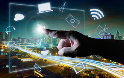 Man touching illustrating social media presentation with his finger on virtual screen. Cyber concept background . city skyline background Stock Photography