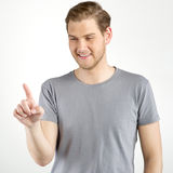 Man touching an imaginary button Royalty Free Stock Photo