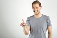 Man touching an imaginary button Stock Photos