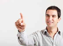 Man touching an imaginary screen Stock Photography