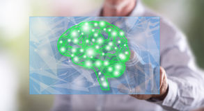 Man touching an intelligence concept on a touch screen Royalty Free Stock Photos
