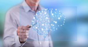 Man touching an intelligence concept on a touch screen Stock Photo