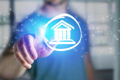 Man touching a justice icon on a futuristic interface - Technolo Stock Image