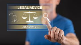 Man touching a legal advice concept on a touch screen Stock Photo