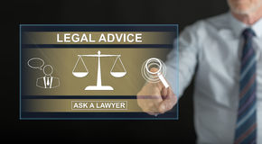 Man touching a legal advice concept on a touch screen Royalty Free Stock Photo
