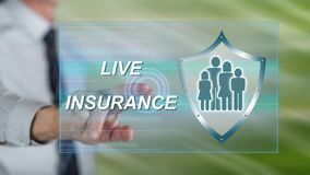 Man touching a life insurance concept. On a touch screen with his finger royalty free stock photos