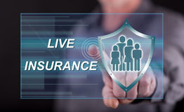 Man touching a life insurance concept on a touch screen. With his finger Stock Photography