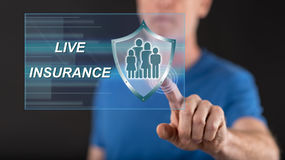 Man touching a life insurance concept on a touch screen. With his finger Stock Image