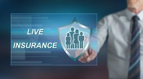 Man touching a life insurance concept. On a touch screen with his finger royalty free stock photo