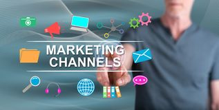 Man touching marketing channels concept. On a touch screen with his finger royalty free stock image