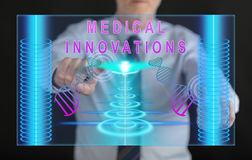 Man touching a medical innovation concept on a touch screen. With his fingers Royalty Free Stock Image