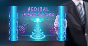 Man touching a medical innovation concept. On a touch screen with a stylus pen stock images