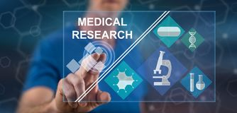 Man touching a medical research concept. On a touch screen with his finger royalty free stock photography