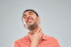 Man touching neck and suffering from throat pain Royalty Free Stock Images