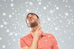 Man touching neck and suffering from throat pain Royalty Free Stock Photography