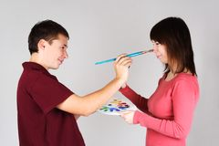 Man touching nose of young girl by brush Royalty Free Stock Images
